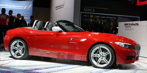 Tire, Wheel, Automotive design, Vehicle, Event, Land vehicle, Performance car, Car, Red, Personal luxury car,