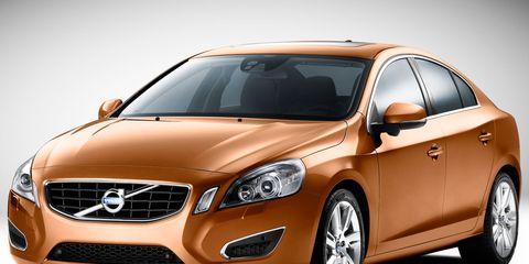 Tire, Motor vehicle, Wheel, Mode of transport, Daytime, Automotive mirror, Automotive design, Vehicle, Glass, Headlamp,