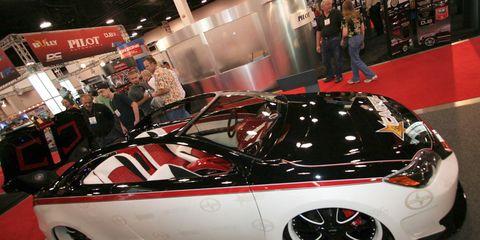 Tire, Automotive design, Vehicle, Rim, Alloy wheel, Fender, Personal luxury car, Auto show, Exhibition, Spoke,