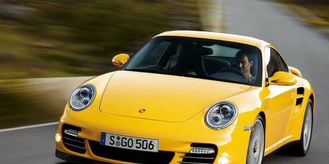 Tire, Motor vehicle, Wheel, Automotive design, Vehicle, Yellow, Land vehicle, Transport, Car, Rim,