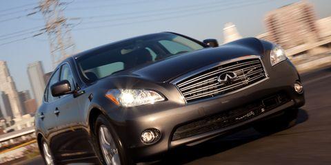 Motor vehicle, Tire, Automotive design, Automotive tire, Daytime, Vehicle, Land vehicle, Automotive lighting, Headlamp, Hood,