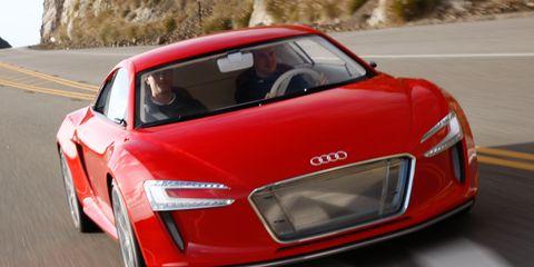 Automotive design, Vehicle, Road, Performance car, Infrastructure, Automotive mirror, Red, Car, Road surface, Automotive lighting,