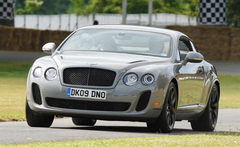 Vehicle, Automotive design, Bentley, Grille, Car, Vehicle registration plate, Rim, Personal luxury car, Luxury vehicle, Flag,