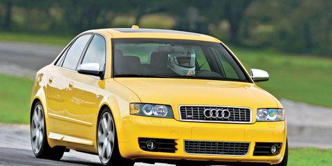Tire, Motor vehicle, Wheel, Automotive design, Daytime, Road, Yellow, Transport, Vehicle, Infrastructure,
