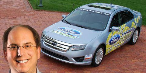 Wheel, Vehicle, Land vehicle, Collar, Dress shirt, Car, Shirt, Headlamp, Grille, Full-size car,