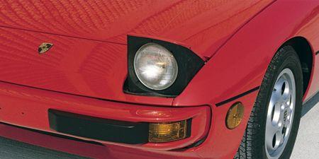 Tire, Automotive tire, Automotive design, Vehicle, Automotive parking light, Automotive lighting, Red, Rim, Car, Alloy wheel,