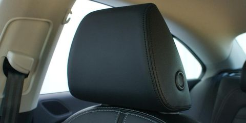 Motor vehicle, Mode of transport, Car seat, Head restraint, Car seat cover, Leather, Vehicle door, Automotive window part, Family car, Luxury vehicle,