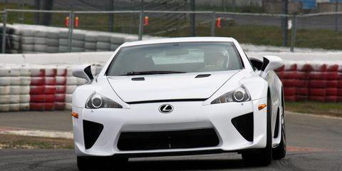 Automotive design, Vehicle, Land vehicle, Car, Performance car, Rim, Supercar, Fender, Sports car, Automotive lighting,