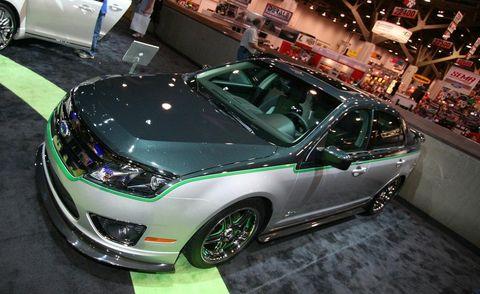 Motor vehicle, Automotive design, Vehicle, Event, Headlamp, Car, Automotive lighting, Hood, Auto show, Exhibition,