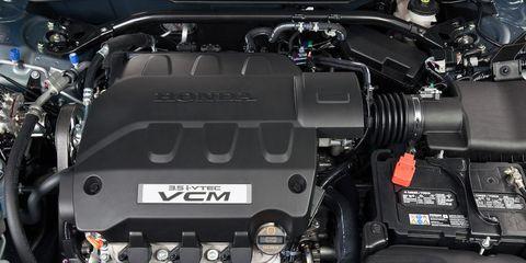 Automotive design, Engine, Automotive engine part, Personal luxury car, Luxury vehicle, Automotive air manifold, Automotive super charger part, Performance car, Kit car, Nut,