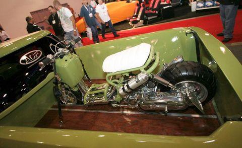 Motor vehicle, Automotive design, Classic, Antique car, Classic car, Logo, Auto show, Exhibition, Auto part, Automotive wheel system,