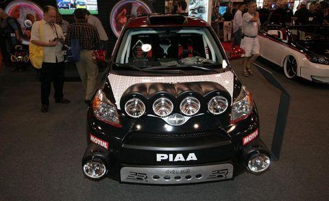 Automotive design, Vehicle, Land vehicle, Automotive lighting, Car, Auto show, Bumper, Headlamp, Exhibition, Personal luxury car,