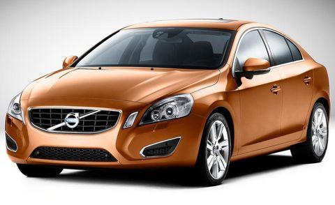 Automotive mirror, Mode of transport, Daytime, Vehicle, Glass, Automotive design, Land vehicle, Headlamp, Grille, Car,