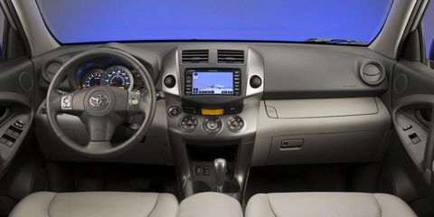 Motor vehicle, Mode of transport, Product, Automotive design, Steering part, Steering wheel, Center console, White, Vehicle audio, Technology,