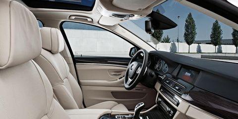Motor vehicle, Automotive mirror, Automotive design, Vehicle, Steering part, Steering wheel, Vehicle door, White, Car, Luxury vehicle,