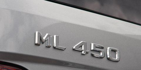 Motor vehicle, Automotive tail & brake light, Automotive exterior, Logo, Grey, Symbol, Trademark, Coquelicot, Brand, Silver,
