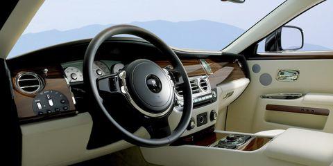 Motor vehicle, Steering part, Mode of transport, Steering wheel, Transport, Vehicle, White, Center console, Speedometer, Vehicle door,