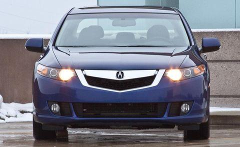 Motor vehicle, Mode of transport, Blue, Daytime, Product, Automotive exterior, Vehicle, Automotive design, Automotive mirror, Glass,