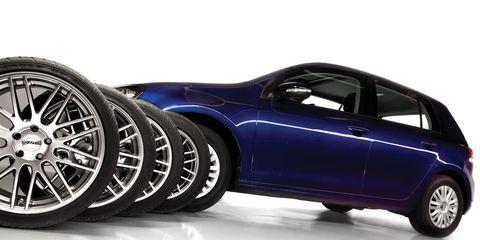 Wheel, Motor vehicle, Tire, Automotive design, Blue, Automotive tire, Automotive wheel system, Rim, Automotive exterior, Alloy wheel,