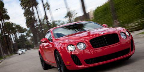 Automotive design, Vehicle, Land vehicle, Automotive lighting, Car, Grille, Bentley, Red, Performance car, Fender,