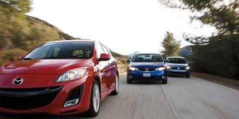 2010 Kia Forte SX vs  2010 Mazda 3 s Sport, 2010 Volkswagen Golf