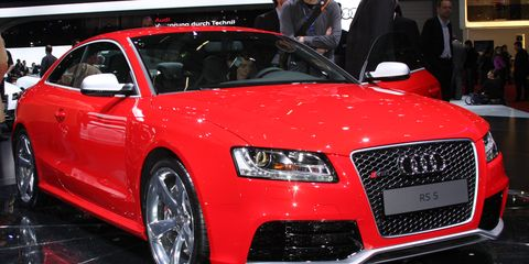 Tire, Wheel, Automotive design, Vehicle, Event, Land vehicle, Car, Grille, Red, Personal luxury car,