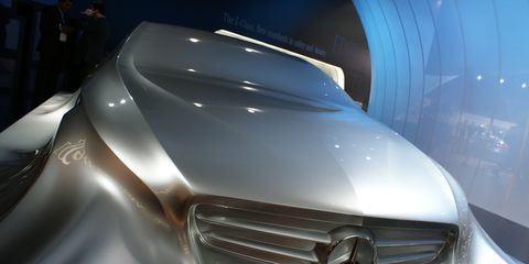 Motor vehicle, Automotive design, Mode of transport, Automotive exterior, Grille, Concept car, Automotive lighting, Logo, Luxury vehicle, Personal luxury car,