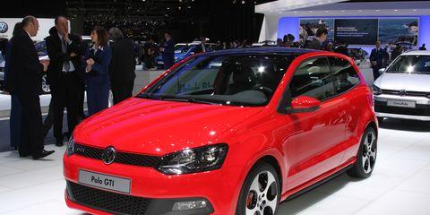 Tire, Wheel, Automotive design, Vehicle, Land vehicle, Event, Car, Auto show, Alloy wheel, Suit,