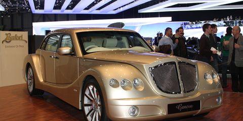 Tire, Mode of transport, Automotive design, Vehicle, Car, Grille, Rim, Fender, Automotive tire, Floor,