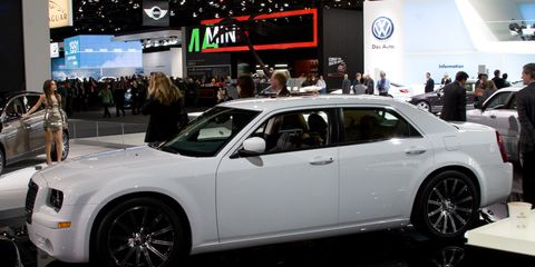 Tire, Wheel, Automotive design, Vehicle, Land vehicle, Event, Rim, Car, Alloy wheel, Personal luxury car,