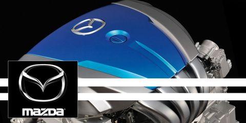 Motor vehicle, Automotive design, Motorcycle, Fender, Automotive lighting, Logo, Motorcycle accessories, Symbol, Azure, Automotive wheel system,
