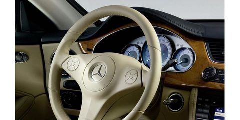 Motor vehicle, Steering part, Mode of transport, Steering wheel, Transport, White, Automotive mirror, Speedometer, Luxury vehicle, Vehicle door,