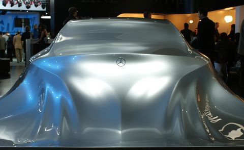 Motor vehicle, Automotive design, Vehicle, Car, Personal luxury car, Concept car, Auto show, Luxury vehicle, Exhibition, Logo,