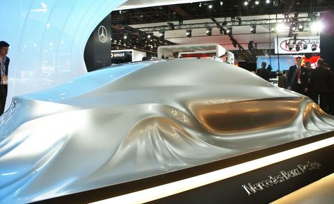 Automotive design, Mode of transport, Concept car, Auto show, Logo, Exhibition, Advertising, Steel, Engineering, Personal luxury car,