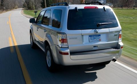 Motor vehicle, Tire, Automotive tail & brake light, Mode of transport, Vehicle, Automotive tire, Automotive exterior, Road, Automotive lighting, Land vehicle,