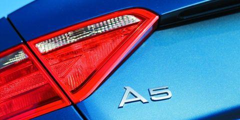 Automotive tail & brake light, Automotive design, Automotive exterior, Automotive lighting, Car, Light, Electric blue, Trunk, Luxury vehicle, Tints and shades,