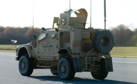 Tire, Wheel, Mode of transport, Automotive tire, Military vehicle, Road surface, Armored car, Fender, Armored car, Asphalt,