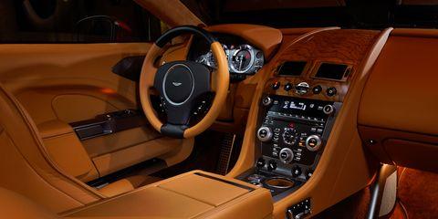 Motor vehicle, Steering part, Brown, Steering wheel, Automotive design, Center console, Vehicle audio, Speedometer, Car seat, Luxury vehicle,