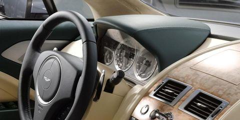 Motor vehicle, Automotive design, Steering part, Steering wheel, White, Center console, Luxury vehicle, Automotive mirror, Vehicle door, Vehicle audio,
