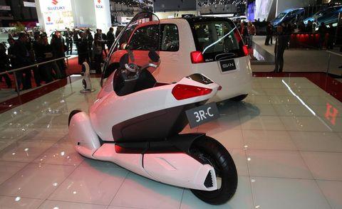 Motor vehicle, Mode of transport, Automotive design, Vehicle, Land vehicle, Floor, Fender, Auto show, Flooring, Exhibition,