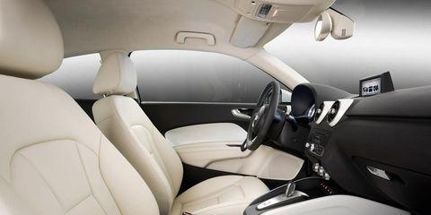 Motor vehicle, Automotive design, Mode of transport, White, Car, Car seat, Vehicle door, Fixture, Car seat cover, Luxury vehicle,