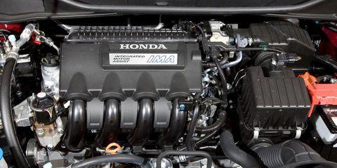 Engine, Automotive engine part, Automotive air manifold, Automotive super charger part, Fuel line, Personal luxury car, Kit car, Automotive fuel system, Nut, Automotive engine timing part,