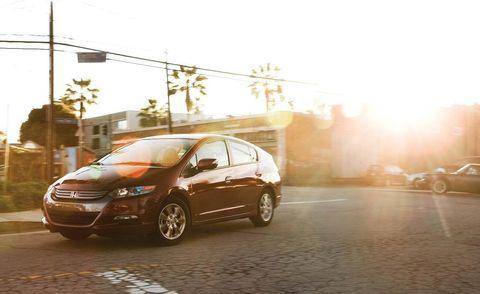 Tire, Wheel, Automotive design, Mode of transport, Automotive mirror, Vehicle, Land vehicle, Automotive tire, Transport, Car,