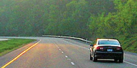Motor vehicle, Road, Mode of transport, Automotive design, Yellow, Road surface, Asphalt, Transport, Infrastructure, Automotive mirror,