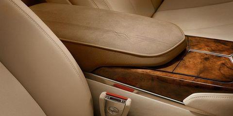 Motor vehicle, Mode of transport, Brown, Tan, Car seat, Leather, Beige, Vehicle door, Khaki, Luxury vehicle,