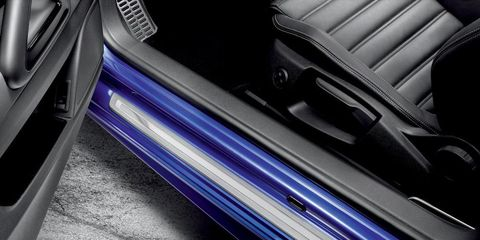 Motor vehicle, Automotive design, Automotive exterior, Fixture, Luxury vehicle, Electric blue, Personal luxury car, Vehicle door, Machine, Carbon,