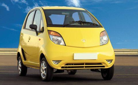 Tire, Motor vehicle, Wheel, Automotive mirror, Mode of transport, Automotive design, Transport, Vehicle, Yellow, Automotive tire,