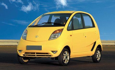 Tire, Motor vehicle, Automotive mirror, Wheel, Mode of transport, Automotive design, Automotive tire, Transport, Yellow, Vehicle,