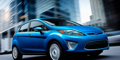 Tire, Motor vehicle, Wheel, Automotive design, Mode of transport, Blue, Daytime, Transport, Vehicle, Automotive tire,