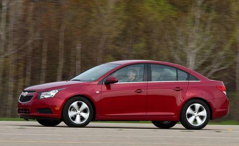 Tire, Wheel, Mode of transport, Automotive design, Vehicle, Automotive mirror, Car, Red, Full-size car, Rim,